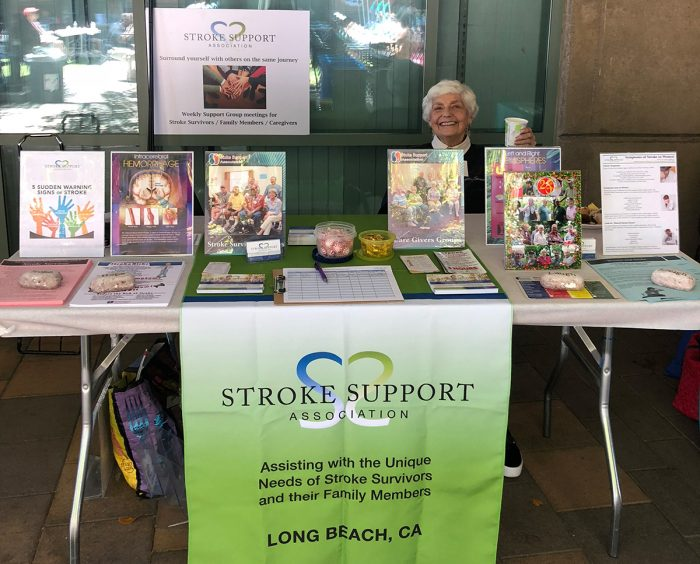 Lois Mosing at the Stroke Support Association table at UCI